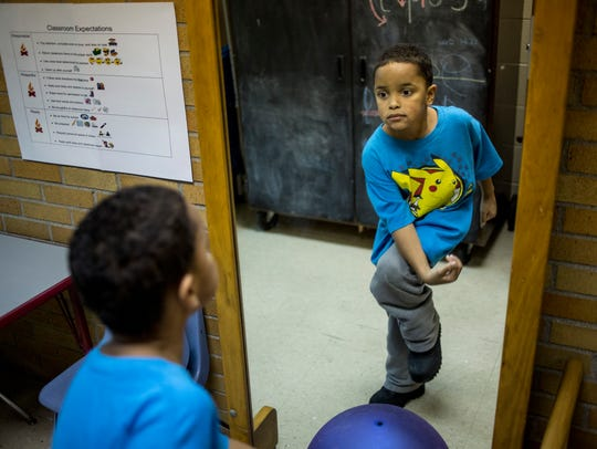 Caleb Wright, 7, does an exercise that helps him retain