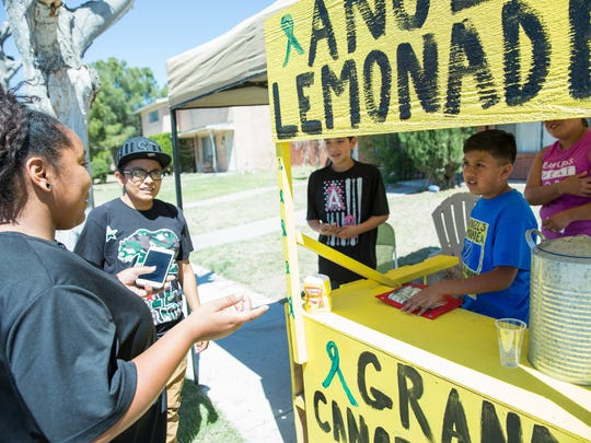 Jhante LeFevre,left, Adrianna Ybarra, stopped by Angel Reyes' lemonade stand, to donate 30 dollars to Angel Reyes, right. Ybarra said she recently lost her grandfather so they wanted to help Angel with his fundraising. Wednesday, March 22, 2017.
