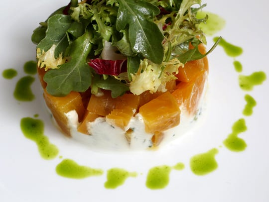 The roasted beet salad with goat cheese, mixed greens,