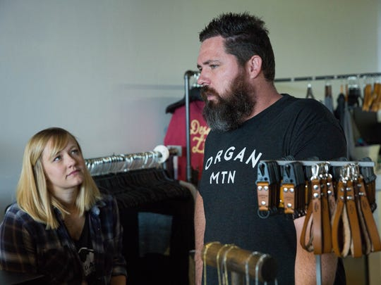 Chris Lang and Kerry Lang, owners of Organ Mountain, talk about their inventory in their new store. Tuesday, Septmeber 26, 2017.