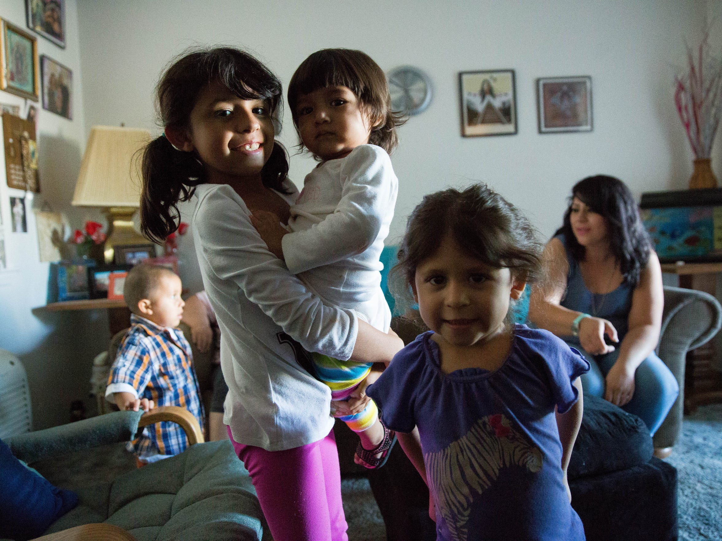 Adrian Pedroza Jr.,2,left, plays  with his mom Adiana Sanchez behind Hazel Sanchez,8, who is holding her cousin Janice Sanchez,1, next to Sophie Pedroza,3, at the Sanchez/Pedroza home. Friday September 29, 2017.