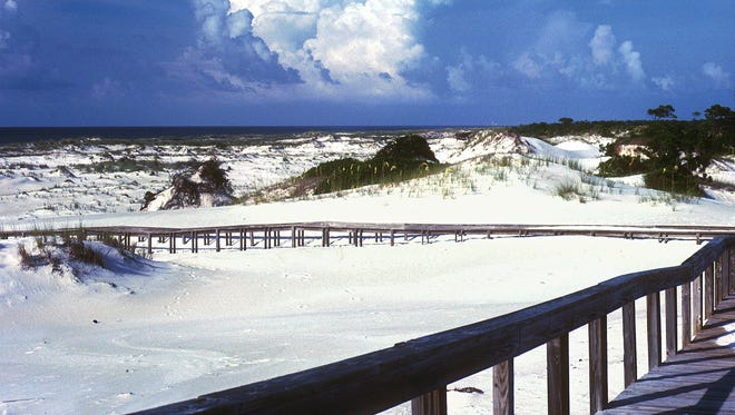 Shifting sands cover a boardwalk at St. George Island's State Park.