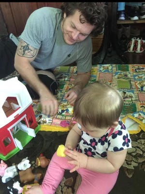 Jacob Faulkner, 32, was shot and killed by a sheriff's deputy on June 20 in Butler County. He is shown here playing with his niece. Jake's family said he suffered from post-traumatic stress disorder.