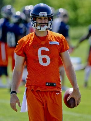 Chicago Bears quarterback Jay Cutler says Michigan's Jim Harbaugh is a coach he could play for.