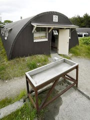 A faucet is seen outside the longhouse-style hut building, where 7-year-old Japanese boy Yamato Tanooka was found safe nearly a week after he was abandoned in a forest by his parents, in a military drill area in Shikabe town on the northernmost main island of Hokkaido.
