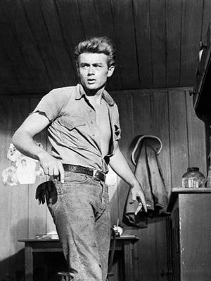 FILE - This 1955 file photo shows actor James Dean. Until the 1950s, jeans had been called overalls or waist overalls, but after teens started referring to them as jeans, Levi?s began using the moniker in ads and packaging. Around the same time, jeans took on a bad-boy image, popularized by teen rebels like James Dean and Marlon Brandy, which led many schools to ban kids from wearing them to class. (AP Photo/File)
