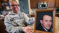 Kim Storm with a picture of her father David Naill.