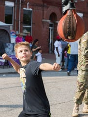 Tate Hodgson, 9, gets ready to knock the punching bag at the National Guard booth resulting in an 89.3 score at the Fall Festival on Friday afternoon.
