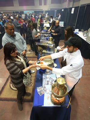 Mario Robles of Pelican's Steak and Seafood served Norma Chavira during last year's Taste of El Paso. The culinary event returns at 6 p.m. Thursday at the convention center Downtown.