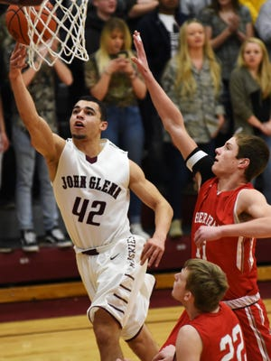 John Glenn's Shane Bonner goes up for a layup over Sheridan's Luken Hill during Friday's game in New Concord. The Muskies and Generals earned top two seeds in their respective tournament draws on Sunday.