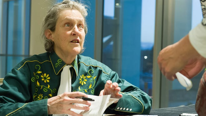 Colorado State University Animal Sciences professor and autism advocate Temple Grandin signs books for community members following the Grandin's President's Community Lecture, April 13, 2015.