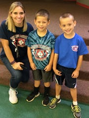 During the Week of Respect, celebrated in New Jersey each year during the week beginning with the first Monday in October, students at Three Bridges School showed their respect for their school and friends by wearing their school spirit wear. School guidance counselor Beth Furka with first graders Graham McLean and Ryan Martin.