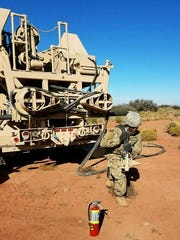 Delta Battery, with 3rd Battalion, 43rd Air Defense Artillery Regiment, runs the power line to the power generator during gunnery.