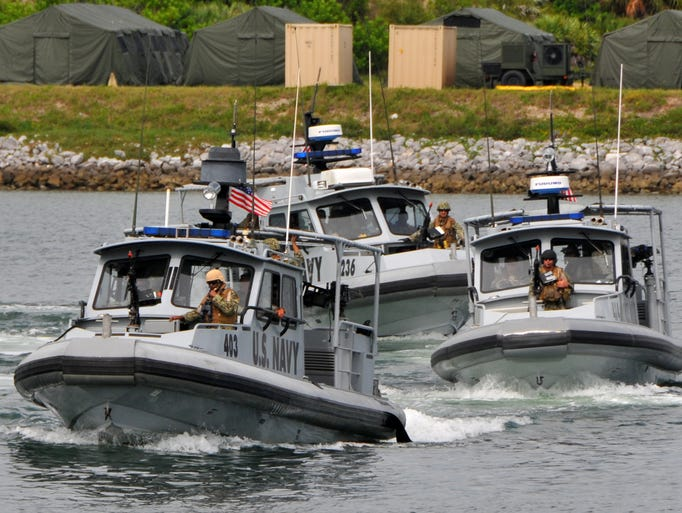 Three 34-foot patrol boats execute maneuvers in theTrident turn basin.