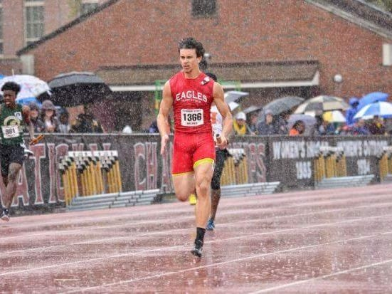 Pine Forest's Marcus Reaves hits his stride in the rain during the running of the 100-meter dash earlier this year.