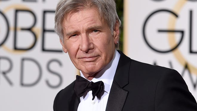 """FILE - In this Jan. 10, 2016 file photo, Harrison Ford arrives at the 73rd annual Golden Globe Awards in Beverly Hills, Calif. Ford will reprise his role as Rick Deckard in the sequel to """"Blade Runner,"""" expected in January of 2018. (Photo by Jordan Strauss/Invision/AP, File)"""
