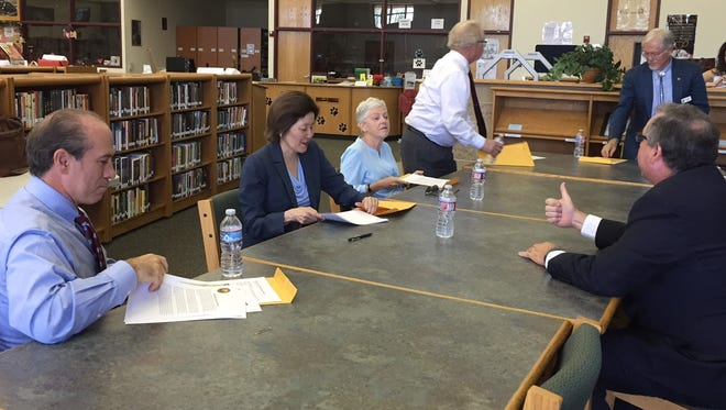 David Bloom, EPA deputy chief financial officer; Jane Nishide, administrator for international and tribal affairs; EPA Administrator Gina McCarthy; EPA Region 6 Administrator Ron Curry; Doña Ana County Commissioner Billy Garrett; and Patrick Peck, director of the South Central Solid Waste Authority meet at Chaparral High School to discuss border health issues.