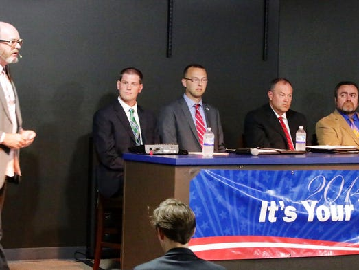 Moderator Rick Dodgson, far left, introduces from left, Tyler Vorpagel, Darryl Carlson, Terry Katsma and Job Hou-Seye during a candidate debate Thursday July 24, 2014 for 26th and 27th assembly seats held at Spaceport Sheboygan.