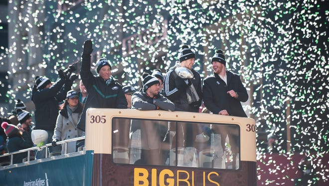 Confetti falls as (From right-left) Eagles quarterback Carson Wentz, Eagles back-up quarterback Nate Sudfeld, Super Bowl MVP Nick Foles and Eagles owner  Jeffrey Lurie ride a float during the  PhiladelphiaEagles Super BowlLIIvictory parade at 16th Street and Ben Franklin Parkway in Philadelphia on Thursday afternoon.
