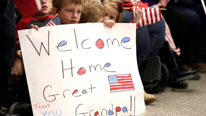Families wait to greet veterans as they return to Appleton International Airport during Old Glory Honor Flight Mission 38 on Oct. 26, 2016.