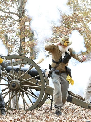 Civil War re-enactors fired canons in salute to Pvt. James Coble to close the commemorative service Saturday at Salem Cemetery in Jackson.