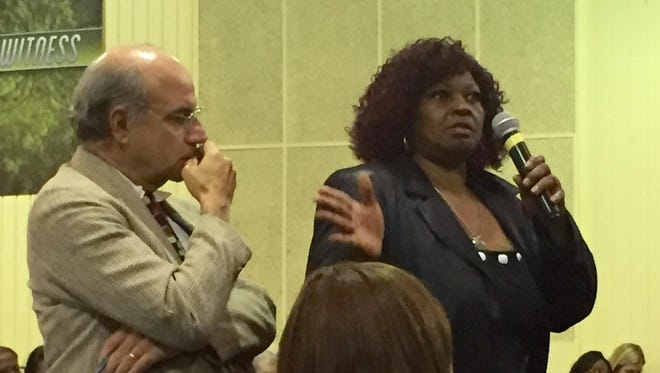 Audrey DuBose, mother of the late Sam DuBose, asks a question Wednesday night during a panel discussion on the upcoming trial of former University of Cincinnati Police Officer Ray Tensing, who is charged with murder and voluntary manslaughter in her son's death. One of the family's attorneys, Al Gerhardstein, stands beside her.