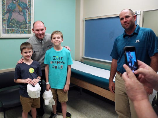 Professional golfers Tommy Gainey and Josh Teater visit Sawyer and Weston Moss at Shriner's Hospitals for Children.