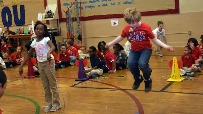 Kennidi Hamilton (left) and Zac Tate, second-graders at Cherokee Elementary School, participate in the school's annual Jump Rope for Heart event Friday. It is a fundraiser for the American Heart Association.