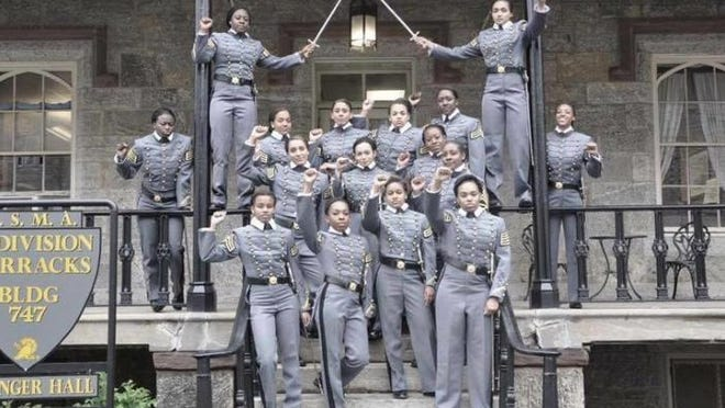 This undated image obtained from Twitter on Saturday shows 16 black, female cadets in uniform with their fists raised while posing for a photograph at the United States Military Academy at West Point. The U.S. Military Academy has launched an inquiry into the image that has spurred questions about whether the gesture violates military restrictions on political activity.