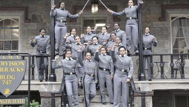 This graduation photo taken from Twitter shows 16 black, female cadets in uniform with their fists raised at the United States Military Academy in West Point, New York.