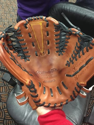 Switch pitcher Pat Venditte shows off his six-fingered mitt. Venditte is only the third ambidextrous pitcher to appear in an MLB game since 1894.