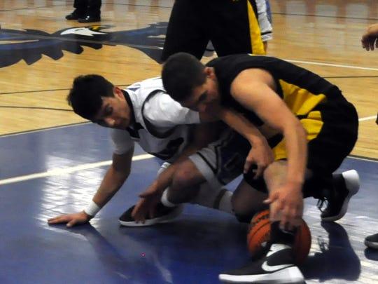Hondo's Jordan Brady battles Coronado's Adriano Duran for possession of the ball.