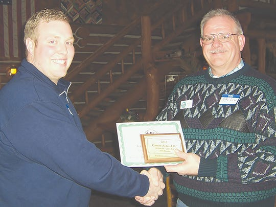 Mike Lee (CRI-Genex) with Eric Carson—5 Year Increase Award, Runner-Up High $Value Herd, Top Red & White Holstein.