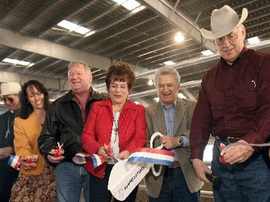 Rene Garcida, Peggy Banales, County Commissioner Pct.1., Chuck Cazalas, County Commissioner Pct.4., Betty Jean Longoria County Commissioner Pct.2, Oscar Ortiz County Commissioner Pct.3, and Loyd Neal, Nueces County Judge, cut a ribbon to official open the Nueces County Richard M. Borchard Regional Fairgrounds Equestrian Center Thursday, January 10, 2008.