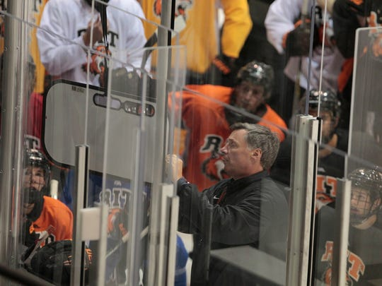 All eyes are on RIT head coach Wayne Wilson as he goes over power play alignments during their practice Wednesday, Oct. 8, 2014 at the Polisseni Center at RIT in Henrietta.