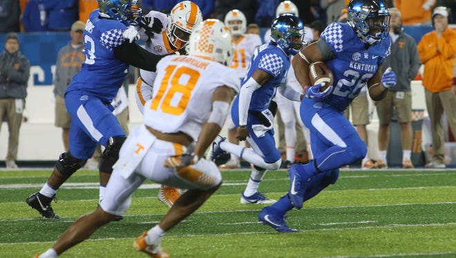 University of Kentucky's Benny Snell Jr. breaks away from the pack, for a long run in the first quarter Of Saturday's night game against Tennessee.