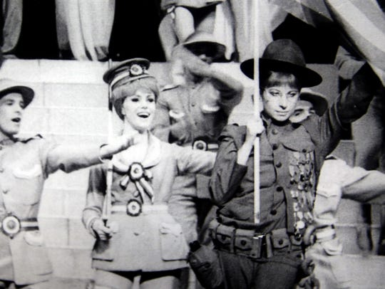 Diane Coupé Frankel, center, performing next to Barbra