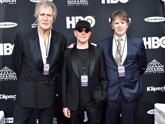 John Illsley, Alan Clark and Guy Fletcher of Dire Straits.