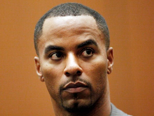 FILE - This Feb. 20, 2014 file photo shows former NFL safety Darren Sharper appearing  in Los Angeles Superior Court in Los Angeles. Lawyers for former NFL All-Pro safety Darren Sharper will return to a Phoenix courtroom Thursday April 17, 2014 to question the evidence being used to keep him in jail without bail on charges that he drugged and sexually assaulted two women. (AP Photo/Los Angeles Times, Bob Chamberlin, Pool, File)