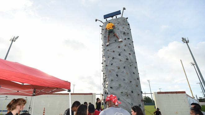 Volunteers tested out Pitshop Rental's Rockwall in preparation for the upcoming Liberation Festival at the Paseo de Susana Park on July 10, 2018.