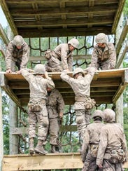Charlie Company participates in an obstacle course