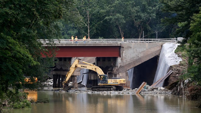 Construction crews repair a bridge over the Wappasening Creek in the Town of Nichols on Friday, July 28, 2017.  Flash flooding compromised the bridge and NYS DOT expects the repairs to be completed by Labor Day Weekend.