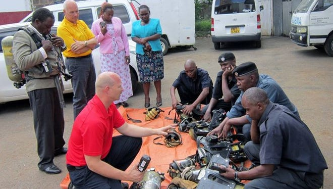 Training is an important part of AFM's outreach. While in Africa, Capt. Todd Rielage, with the fire department in Fishers, Indiana, talks with about fire equipment in a training session. His father, Robert Rielage, is a career firefighter who served with departments in Colerain Township and the city of Wyoming, as well as serving as the Ohio Fire Marshal under Gov. Bob Taft.