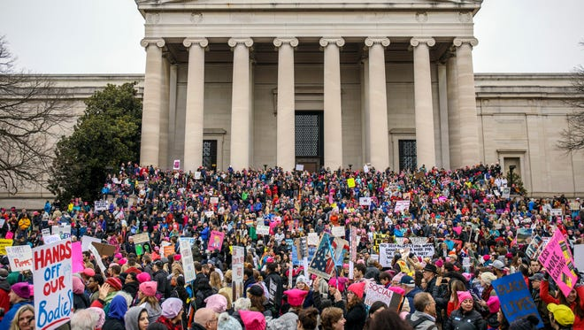 Demonstrators wait for the march to begin Saturday on the National Mall during the Women's March on Washington.