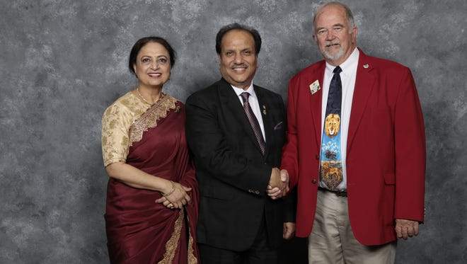 Pictured from left to right are Navita and Lions International President Naresh Aggarwal of Delhi, India and Dave Stockum, Ohio Lions District Governor.