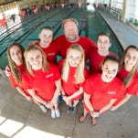 Members of the Y-Spartaquatics swim team back row from left, Ali Snover, Heyward Brown, Peter Wright, coach, Brad Oberg and Ali Galyer; front row from left, Katrina Konopka, Savanna Faulconer and Jessi Snover, celebrate their national YMCA championship.