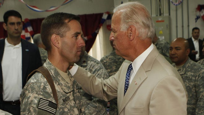 Vice President Joe Biden (right) talks with his son, Army Capt. Beau Biden in Iraq in 2009.
