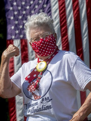 Mae Krier, 94, of Bristol Township, one of the original Rosie the Riveters, wears one of the face masks she has made during the COVID-19 pandemic.
