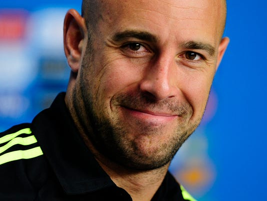 FILE - In this June 22, 2014 file photo Spain's goalkeeper Pepe Reina smiles during an official press conference the day before the group B World Cup soccer match between Spain and Australia at the Arena da Baixada stadium in Curitiba, Brazil. Bayern Munich is set to sign Reina on a three-year deal. Bayern said Reina will sign a contract with the Bundesliga champions on Friday, Aug. 8, 2014, joining as a backup to first-choice keeper Manuel Neuer, who is also Germany's No. 1. He passed a medical on Thursday evening. (AP Photo/Manu Fernandez, File)