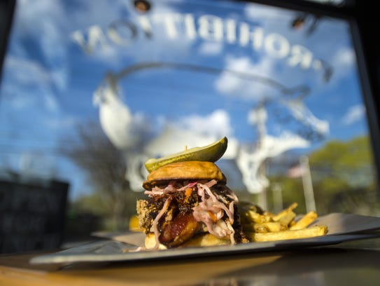 The Pro Pig burger with duck fat fries at Prohibition